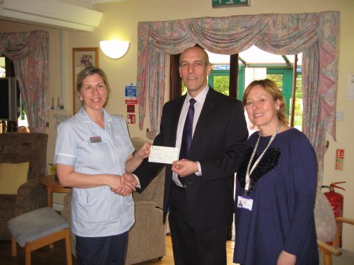 Presentation to Woking Hospice of cheque for £1076.06
